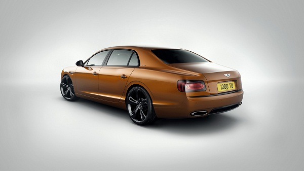 British car maker Bentley has introduced the new version of its Flying Spur series codenamed as W12 S and has endorsed it as the fastest product to come out from its production unit located in Crewe. The four door luxurious sedan is energized with 6.0 litre W12 engine churning the power of 626 hp and torque of 820Nm. The fastest four door sedan is capable to touching the top notch of 325 km/h followed by efficiency of hitting the mark from standstill to 100 km/h in the span of 4.5 seconds. The power to four wheels is sent in the ratio of 40:60 front rear torque split, whereas the suspension system has tuned with advanced damper and stability controlling features. With this the UK based car maker has also offered the option of Carbon Ceramic Brakes. On the exteriors the ever fast Flying Spur has been developed with bunch of new features comprising of Beluga gloss radiator grille, light surrounds, carbon fibre trim pieces (as optional) and rear diffuser. The front and rear have been upgraded with dark surroundings. The side profile has been developed with glossy black 21 inch 7 spoke wheels as standard feature and also an option of 21 inch 5 spoke wheels.  Inside the cabin car maker has endeavored to offer complete comfort to the passengers and therefore the passengers at the rear portion have the facility of enjoying beverages while going for long drive. Well, integration of rear seat mounted shelf for carrying beverages is not an end of feature. The refrigerating shelf has  been developed with an option of frosted glass with chromed metal and illuminated cabinet made from tough wood followed by dual crystal decanters and steel hip flask.  Addressing the launch of new Flying Spur W12 S, Wolfgang Dürheimer, Chairman and Chief Executive of Bentley Motors said, the new Flying Spur W12 S is the best illustration of sedan with superior performance.