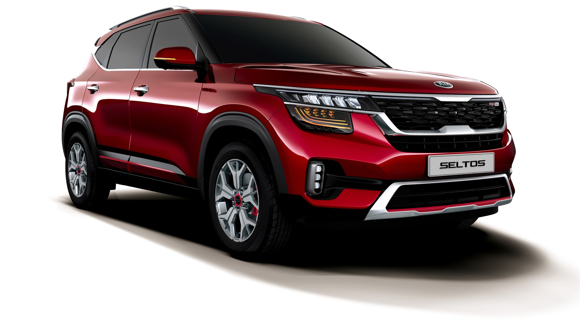 """The Korean carmaker Kia Motors has updated the subcompact SUV Sonet and Seltos in the Indian car market. The prices of both the vehicles now starts from Rs 6.79 lakh and Rs 9.95 lakh respectively. Both the prices are ex-showroom prices. Speaking about the features introduced in the upgraded versions of both the vehicles include newly designed logo. The other features include the integration of paddle shifters in the automatic trims of both the Sonet and Seltos. Along with these features the company has also introduced iMT technology in the HTK+ variant of Seltos empowered with a 1.5-litre petrol engine.  Speaking the launch of updated Sonet and Seltos, Kookhyun Shim, Managing Director and Chief Executive Officer, Kia India said, """"The refreshed editions of Seltos and Sonet mark the first steps towards our transformation in India and reiterate our new brand purpose of inspiring consumers through products, services and their experiences with the brand. The evolving needs of the customers are at the heart of our product strategy. Since launch, the Seltos and Sonet have been creating benchmarks in their respective segments, and with the additional variants, safety and convenience features, we are taking the game a notch higher. I am confident that Indian customers will keep showering their love on our products, and with these refreshed versions, we are ready to win India's heart once again.""""  Under the hood, the 2021 Seltos continues to be offered with the same existing engine options of 1.5-litre Smartstream petrol, 1.4-litre Smartstream T-GDI petrol, and 1.5-litre CRDi VGT diesel.  The transmission options include a 6-speed manual, an Intelligent Variable Transmission (iVT), a 6-speed torque converter, a 7-speed DCT automatic and a 6-speed iMT (Intelligent Manual Transmission). The 2021 Sonet comes equipped with 1.2-litre naturally aspirated petrol engine, 1.0-litre Turbo T-GDI petrol and a 1.5-litre diesel engine. The options for transmission includes a five-speed man"""
